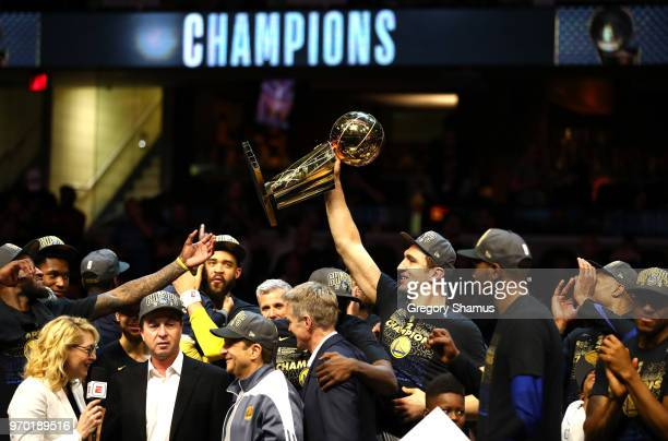 Zaza Pachulia of the Golden State Warriors celebrates with the Larry O'Brien Trophy after defeating the Cleveland Cavaliers during Game Four of the...