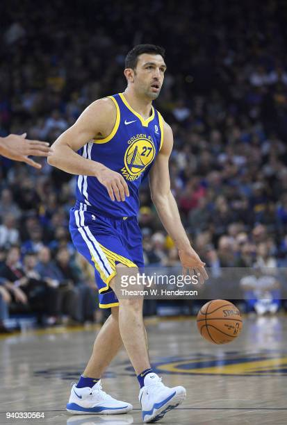 Zaza Pachulia of the Golden State Warriors dribbles the ball against the Utah Jazz during an NBA basketball game at ORACLE Arena on March 25 2018 in...