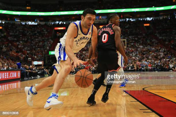 Zaza Pachulia of the Golden State Warriors dribbles the ball under pressure from Josh Richardson of the Miami Heat at American Airlines Arena on...