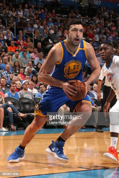 Zaza Pachulia of the Golden State Warriors drives to the basket against the Oklahoma City Thunder on March 20 2017 at Chesapeake Energy Arena in...