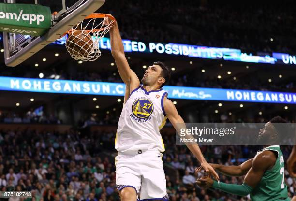 Zaza Pachulia of the Golden State Warriors dunks against Jaylen Brown of the Boston Celtics during the first quarter at TD Garden on November 16 2017...