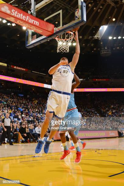 Zaza Pachulia of the Golden State Warriors dunks the ball during the game against the Sacramento Kings on March 16 2018 at ORACLE Arena in Oakland...