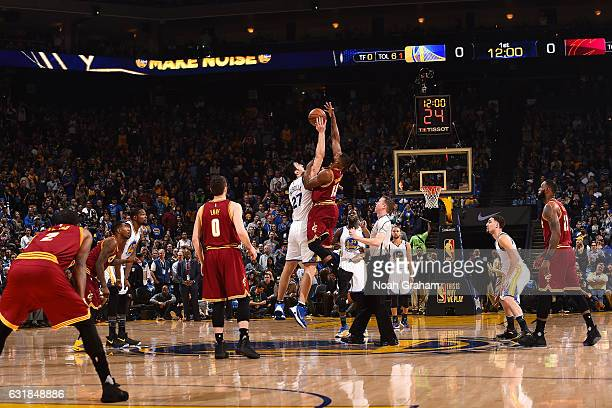 Zaza Pachulia of the Golden State Warriors goes for the tip off against Tristan Thompson of the Cleveland Cavaliers on January 16 2017 at ORACLE...