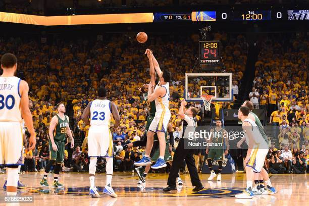 Zaza Pachulia of the Golden State Warriors goes for the tip off against Rudy Gobert of the Utah Jazz during Game One of the Western Conference...