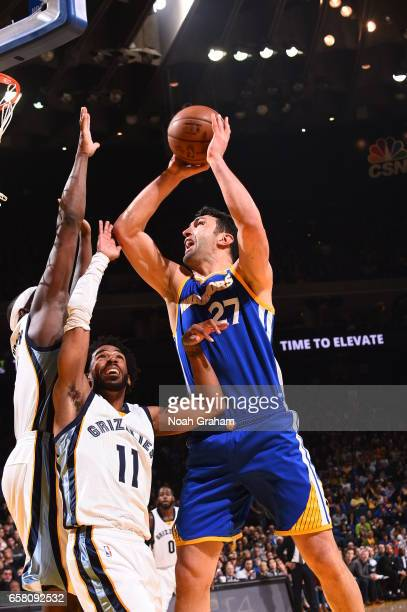 Zaza Pachulia of the Golden State Warriors goes to the basket against the Memphis Grizzlies on March 26 2017 at ORACLE Arena in Oakland California...