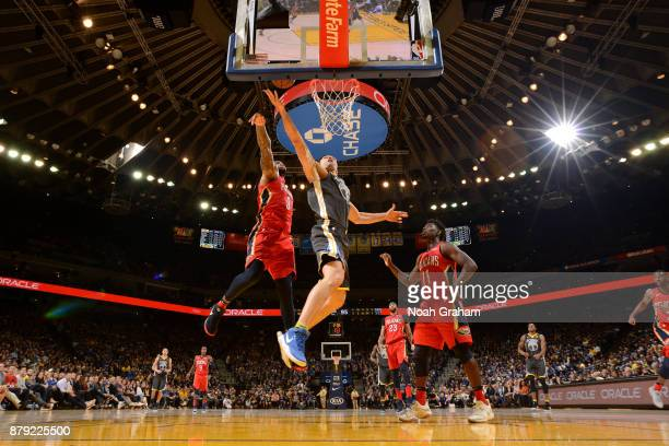 Zaza Pachulia of the Golden State Warriors goes to the basket against the New Orleans Pelicans on November 25 2017 at ORACLE Arena in Oakland...