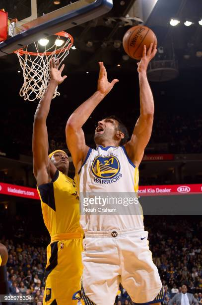 Zaza Pachulia of the Golden State Warriors goes to the basket against the Indiana Pacers on March 27 2018 at ORACLE Arena in Oakland California NOTE...