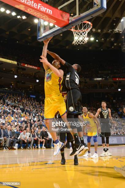Zaza Pachulia of the Golden State Warriors goes to the basket against the Milwaukee Bucks on March 29 2018 at ORACLE Arena in Oakland California NOTE...