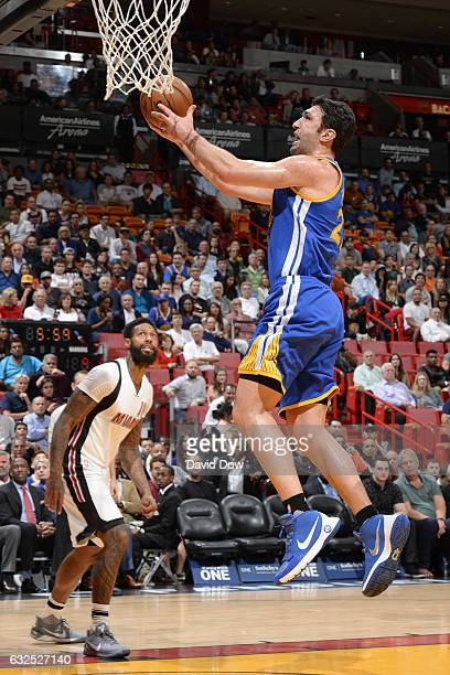 Zaza Pachulia of the Golden State Warriors goes up for a lay up against the Miami Heat on January 23 2017 at American Airlines Arena in Miami Florida...