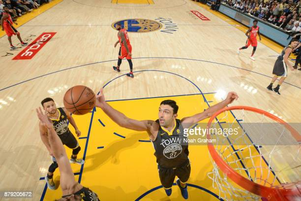 Zaza Pachulia of the Golden State Warriors goes up for a rebound against the New Orleans Pelicans on November 25 2017 at ORACLE Arena in Oakland...