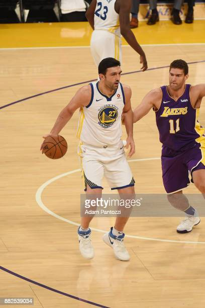 Zaza Pachulia of the Golden State Warriors handles the ball against Brook Lopez of the Los Angeles Lakers on November 29 2017 at STAPLES Center in...