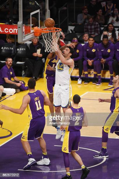 Zaza Pachulia of the Golden State Warriors handles the ball against the Los Angeles Lakers on November 29 2017 at STAPLES Center in Los Angeles...
