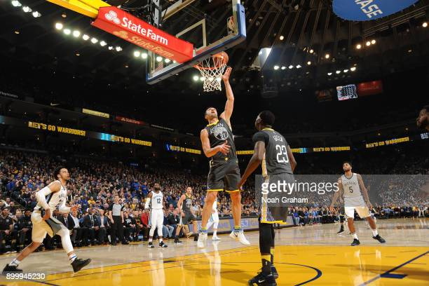 Zaza Pachulia of the Golden State Warriors handles the ball against the Memphis Grizzlies on December 30 2017 at ORACLE Arena in Oakland California...