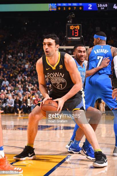 Zaza Pachulia of the Golden State Warriors handles the ball against the Oklahoma City Thunder on February 6 2018 at ORACLE Arena in Oakland...