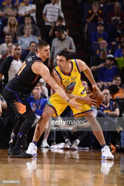 Zaza Pachulia of the Golden State Warriors handles the ball against the Phoenix Suns on March 17 2018 at Talking Stick Resort Arena in Phoenix...