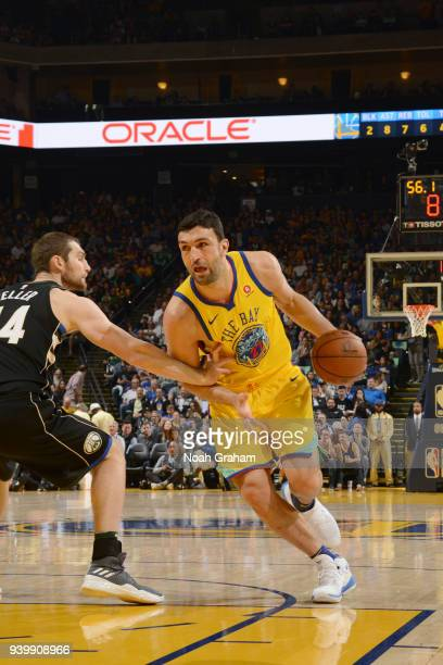 Zaza Pachulia of the Golden State Warriors handles the ball against the Milwaukee Bucks on March 29 2018 at ORACLE Arena in Oakland California NOTE...