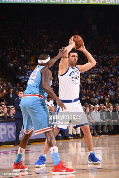 Zaza Pachulia of the Golden State Warriors handles the ball during the game against the Sacramento Kings on March 16 2018 at ORACLE Arena in Oakland...