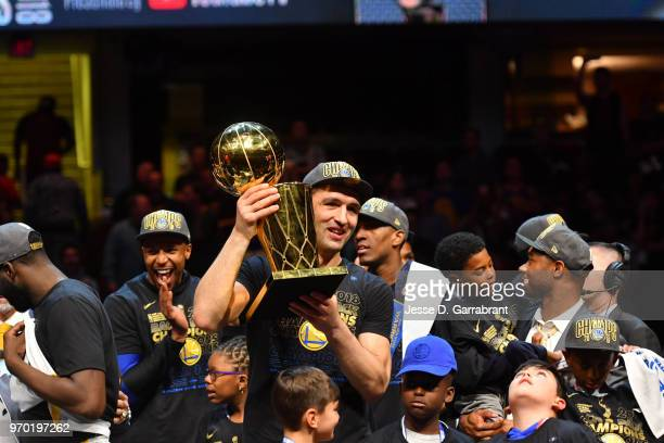 Zaza Pachulia of the Golden State Warriors holds the Larry O'Brien Championship trophy after defeating the Cleveland Cavaliers in Game Four of the...