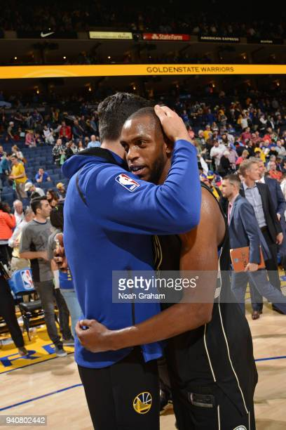 Zaza Pachulia of the Golden State Warriors hugs Eric Bledsoe of the Milwaukee Bucks after the game between the two teams on March 29 2018 at ORACLE...