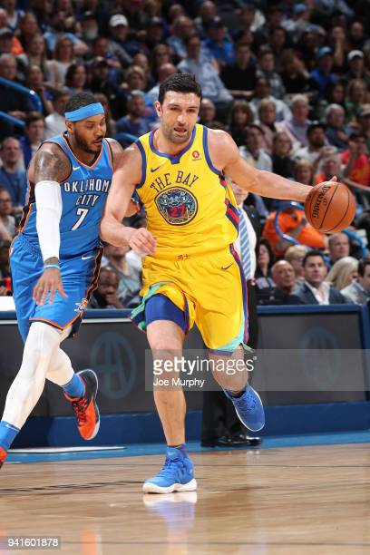 Zaza Pachulia of the Golden State Warriors jocks for a position against Carmelo Anthony of the Oklahoma City Thunder during the game on April 3 2018...