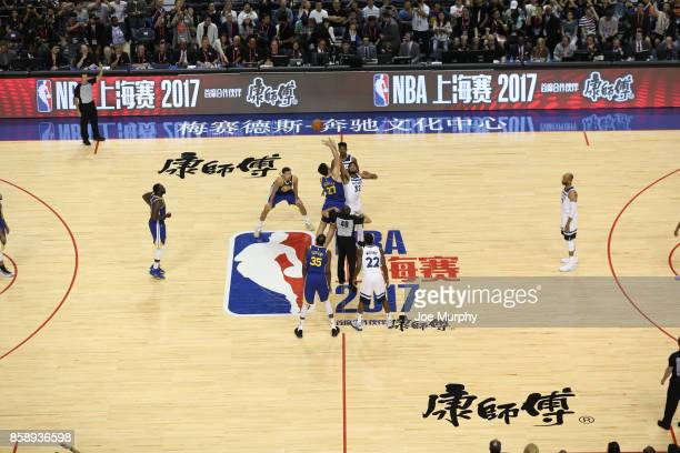 Zaza Pachulia of the Golden State Warriors jumps the opening tip against KarlAnthony Towns of the Minnesota Timberwolves as part of the 2017 Global...