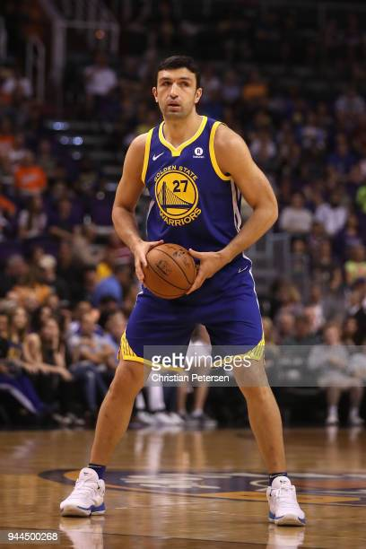 Zaza Pachulia of the Golden State Warriors looks to pass during the first half of the NBA game against the Phoenix Suns at Talking Stick Resort Arena...