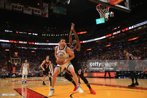 Zaza Pachulia of the Golden State Warriors looks to shoot under pressure from Dion Waiters of the Miami Heat at American Airlines Arena on December 3...