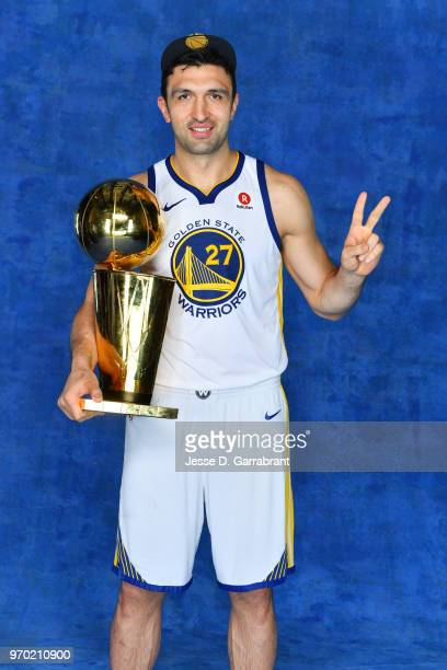 Zaza Pachulia of the Golden State Warriors poses for a portrait with the Larry O'Brien Championship trophy after defeating the Cleveland Cavaliers in...