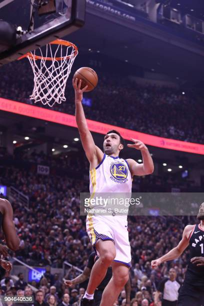 Zaza Pachulia of the Golden State Warriors shoots a layup during the game against the Toronto Raptors on January 13 2018 at the Air Canada Centre in...