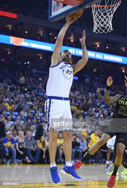 Zaza Pachulia of the Golden State Warriors shoots against the Atlanta Hawks during an NBA basketball game at ORACLE Arena on March 23 2018 in Oakland...