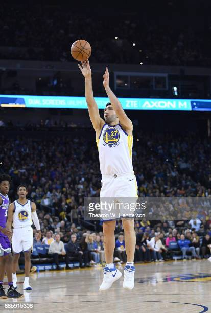 Zaza Pachulia of the Golden State Warriors shoots against the Sacramento Kings during their NBA basketball game at ORACLE Arena on November 27 2017...