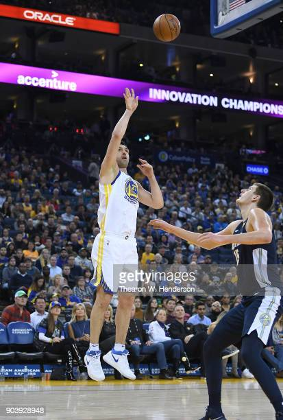 Zaza Pachulia of the Golden State Warriors shoots over Nikola Jokic of the Denver Nuggets during an NBA Basketballl game at ORACLE Arena on January 8...