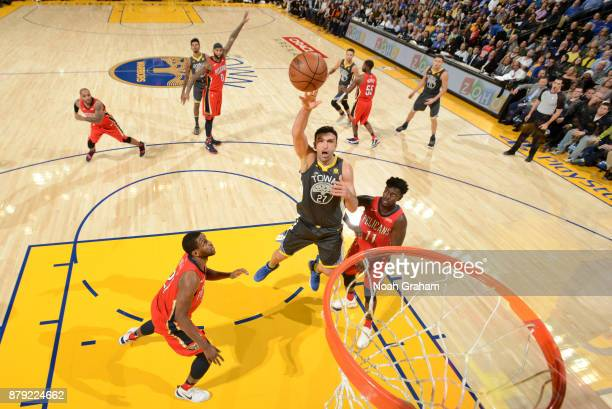 Zaza Pachulia of the Golden State Warriors shoots the ball against the New Orleans Pelicans on November 25 2017 at ORACLE Arena in Oakland California...