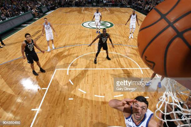 Zaza Pachulia of the Golden State Warriors shoots the ball against the Milwaukee Bucks on January 12 2018 at the BMO Harris Bradley Center in...