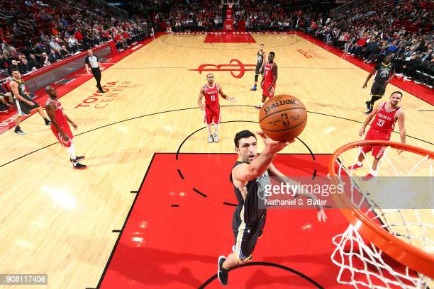 Zaza Pachulia of the Golden State Warriors shoots the ball against the Houston Rockets on January 20 2018 at the Toyota Center in Houston Texas NOTE...