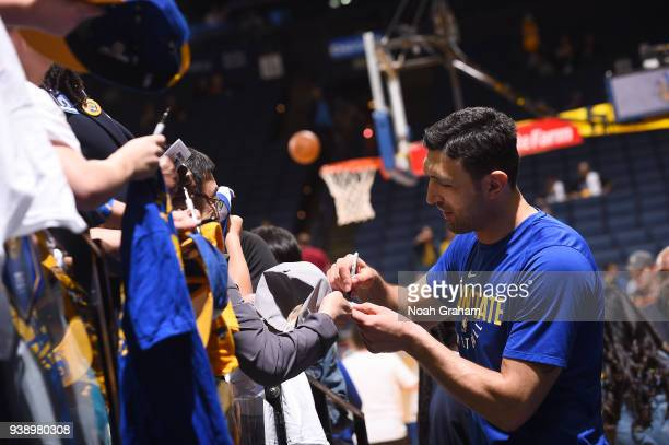 Zaza Pachulia of the Golden State Warriors signs autographs for fans before the game against the Indiana Pacers on March 27 2018 at ORACLE Arena in...