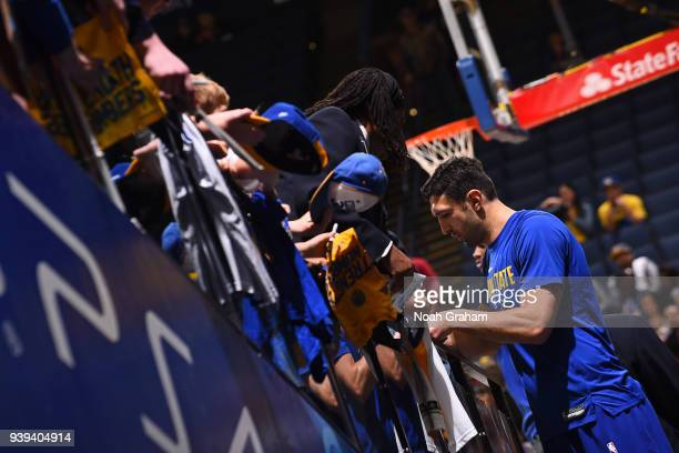 Zaza Pachulia of the Golden State Warriors signs autographs for fans prior to the game against the Indiana Pacers on March 27 2018 at ORACLE Arena in...