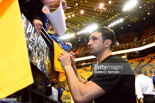 Zaza Pachulia of the Golden State Warriors signs autographs for fans before the game against the San Antonio Spurs in Game Two of Round One of the...