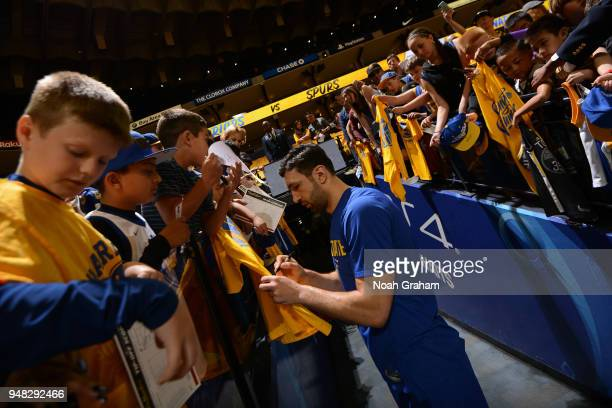 Zaza Pachulia of the Golden State Warriors signs autographs prior to Game One of Round One of the 2018 NBA Playoffs against the San Antonio Spurs on...