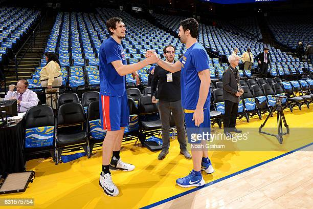 Zaza Pachulia of the Golden State Warriors talks with Boban Marjanovic of the Detroit Pistons before the game on January 12 2017 at ORACLE Arena in...