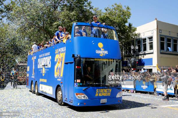 Zaza Pachulia of the Golden State Warriors waves to the fans during the Victory Parade and Rally on June 15 2017 in Oakland California at The Henry J...