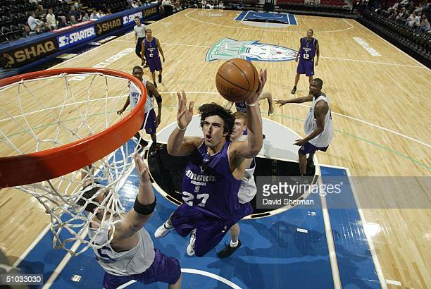 Zaza Pachulia of the Milwaukee Bucks puts the shot up againt Rafael Araujo of the Toronto Raptors during the 2004 NBA Minnesota Summer League on July...