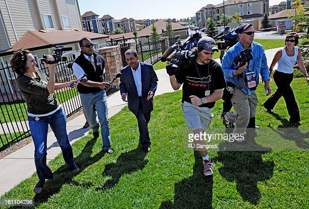 ZAZI19Mohammed Zazi the father of Najibullah Zazi waves off reporters as he leaves his son's apartment to move a car at the Vistas apartment complex...