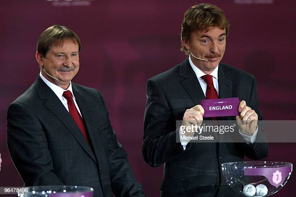 Zbigniew Boniek draws England into Group G alongside Andrzej Szarmach during the Euro2012 Qualifying Draw at the Palace of Culture and Science on...