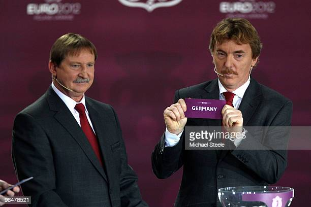Zbigniew Boniek draws Germany into Group A alongside Andrzej Szarmach during the Euro2012 Qualifying Draw at the Palace of Culture and Science on...
