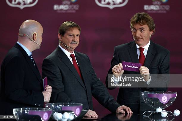 Zbigniew Boniek draws Scotland into Group I alongside Andrzej Szarmach and Gianni Infantino general secretary of UEFA during the Euro2012 Qualifying...