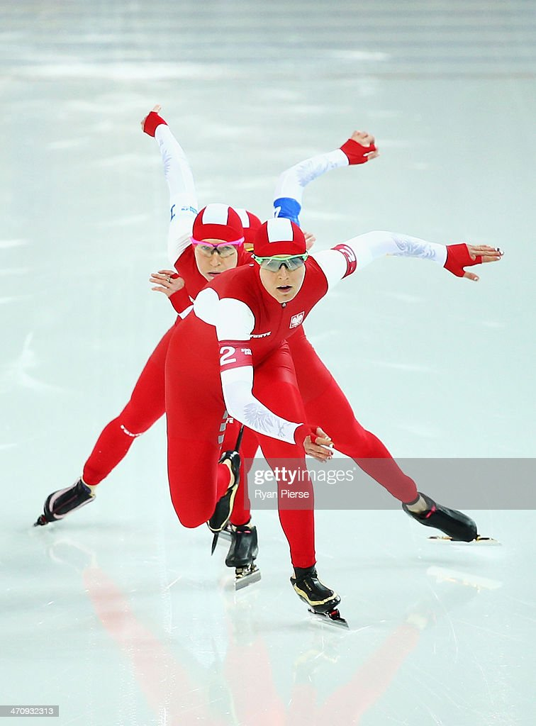Zbigniew Brodka, Jan Szymanski and Konrad Niedzwiedzki of Poland compete during the Men's Team Pursuit Quarterfinals Speed Skating event on day fourteen of the Sochi 2014 Winter Olympics at Adler Arena Skating Center on February 21, 2014 in Sochi, Russia.