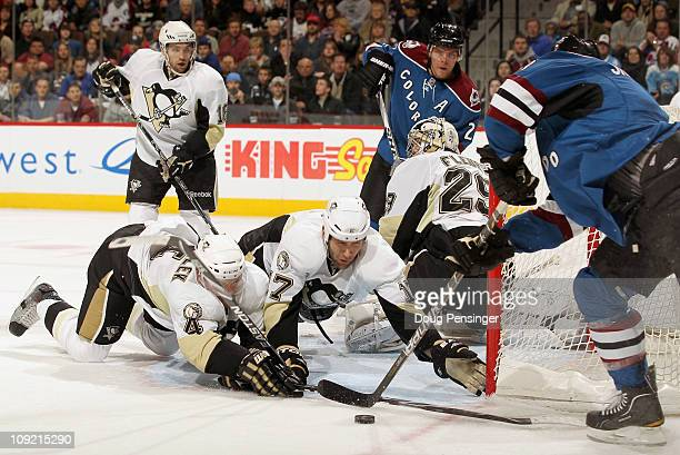 Zbynek Michalek and Michael Rupp of the Pittsburgh Penguins help goalie MarcAndre Fleury defend the goal as Kevin Shattenkirk of the Colorado...
