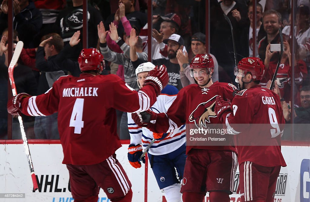 Zbynek Michalek #4, Mikkel Boedker #89 and Sam Gagner #9 of the Arizona Coyotes celebrate after Boedker scored a hat trick goal against the Edmonton Oilers during the third period of the NHL game at Gila River Arena on October 15, 2014 in Glendale, Arizona. The Coyotes defeated the Oilers 7-4.