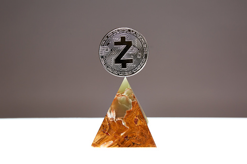 Z-Cash Coin floating above an Onyx Stone Pyramid - gettyimageskorea